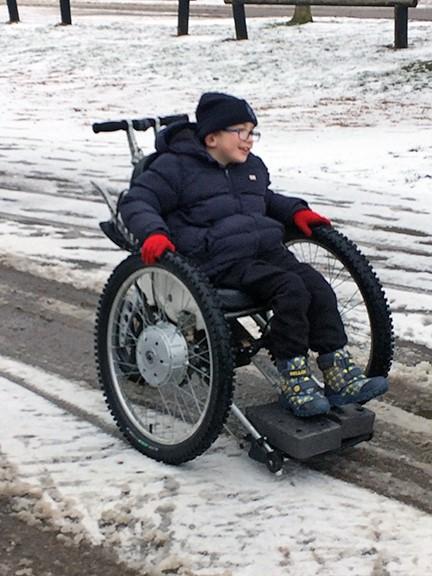 Trekinetic three-wheeled chair in the snow